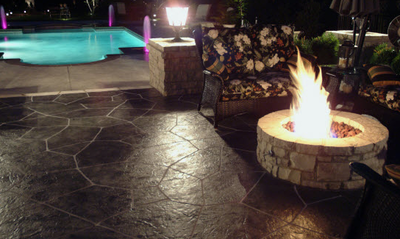 Dark brown stamped patio with built in fire pit.