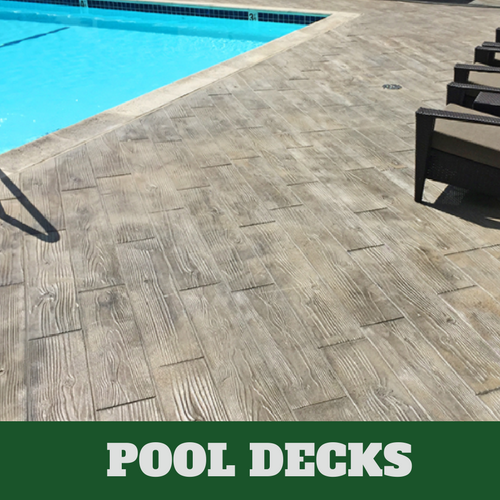 Roanoke stamped concrete pool surround with a wood grain finish.